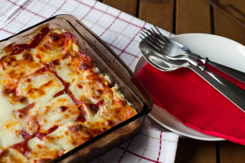 This baked creamy tortellini, inspired by the Queen of the Red Kitchen, features a creamy béchamel sauce topped with red sauce and cheese and baked. | recipe by Chattavore