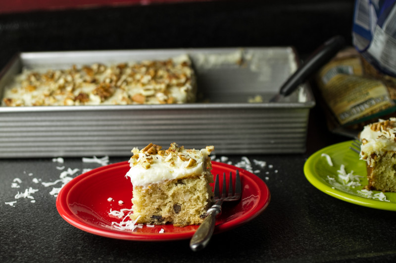 Italian cream sheet cake is a classic Southern cake made simple in a sheet pan. With cream cheese icing, pecans, and coconut, it's perfect! | recipe from Chattavore