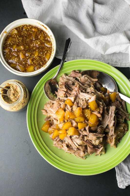Slow cooker pork shoulder with peach white wine sauce is so easy and delicious, and it will give you tons of leftovers to make into other tasty dishes!   Recipe from Chattavore.com