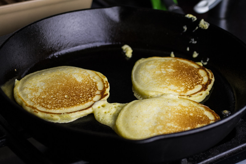 Cornmeal pancakes are homey and filling. Blueberry maple syrup is so much better than any flavored syrup at your local pancake house! | recipe from chattavore.com