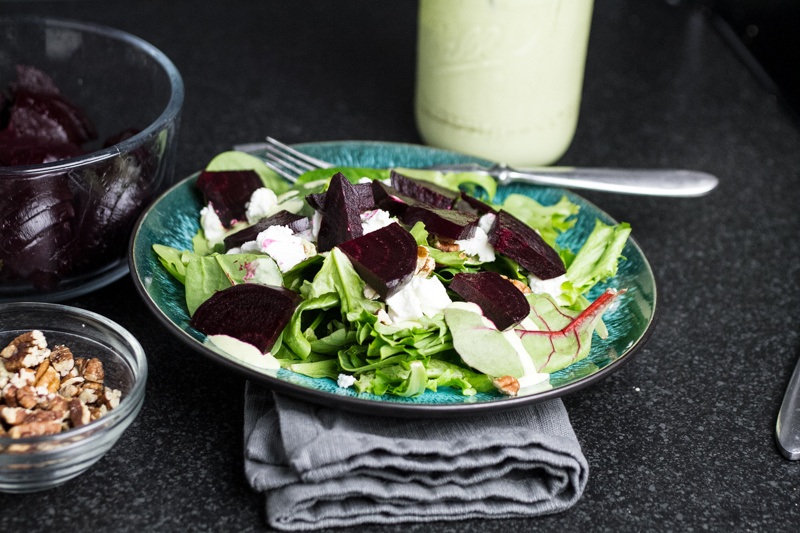This beet salad with goat cheese is fresh and full of vibrant flavors. A homemade green goddess dressing ties the whole thing together! | recipe from Chattavore.com