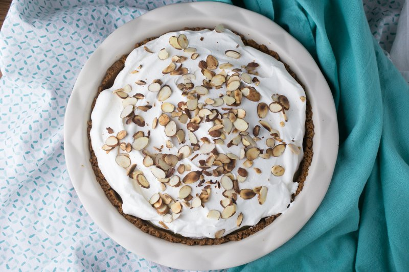 Who doesn't love a delicious pie? With a cookie crust, a custard filling, and a cream topping, this amaretto pie is perfect for holidays or every day! | recipe from Chattavore.com