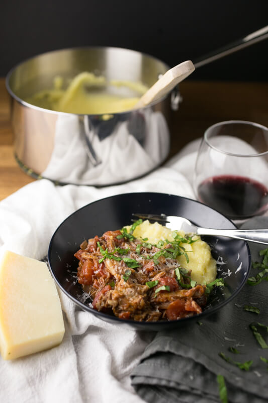 This pork ragu with polenta is a delicious, warming, rib-sticking way to make over leftover pork shoulder or other pork you might have around. | Recipe from Chattavore.com
