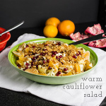 This warm cauliflower salad is healthy, with clementine sections and pomegranate seeds, but also lush with vinaigrette, pine nuts, and buttered bread crumbs. | Recipe from Chattavore.com