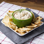 This rosemary-garlic cannellini bean dip is like supercharged hummus. It's so easy to make, and it's best served warm with crackers or vegetables! | recipe from Chattavore.com