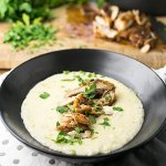 Fall is coming up, and that means it's time for warm comforting meals. These cheesy, creamy grits topped with Cajun chicken thighs fit the bill! | recipe from Chattavore.com
