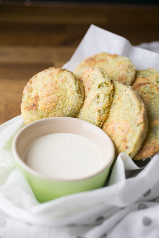 Fried green tomatoes are Southern food at its best, but oven-fried green tomatoes take the messy, popping oil factor out of the equation!   Recipe from Chattavore.com