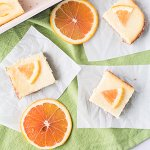 6-ingredient orange cheesecake bars are delicious and sunny and just what you need right now if you are dreaming of warm weather! #cheesecakebars #desserts #springdesserts | Chattavore.com